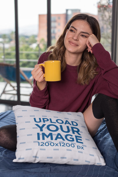 Pillow Mockup Featuring a Gorgeous Young Woman Holding a Coffee Mug at Home 23569