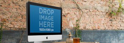 Mockup of an iMac at a Creative Office 4865a
