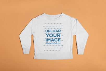 Mockup of a Crewneck Sweater Lying on a Flat Surface 23844