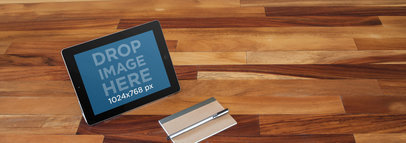 Mockup of an iPad on Top of a Wooden Table  a5037 wide