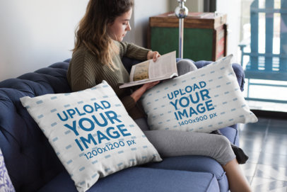 Mockup of a Woman Reading Next to Two Throw Pillows 23575