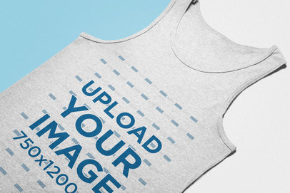 Angled View Mockup of a Heather Tank Top Lying on a Flat Surface 24260