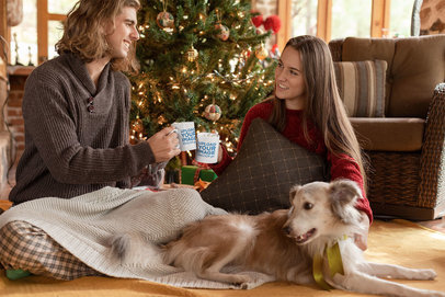 Mug Mockup of a Cute Couple Drinking Hot Cocoa by a Christmas Tree 23517
