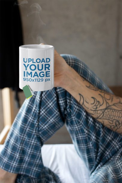 Mug Mockup Featuring a Tattooed Man in His Pajamas 24015