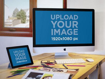 Mockup of an iMac and an iPad at a Design Studio a5115
