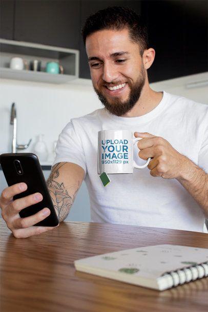 Mug Mockup of a Tattooed Man Having Some Tea at Home 24017