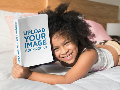 Mockup of a Smiling Girl Reading a Book on her Bed 23705
