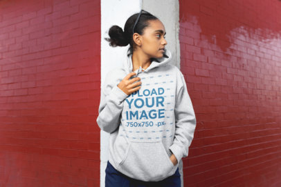 Hoodie Mockup of a Girl Looking Away on the Street 24307
