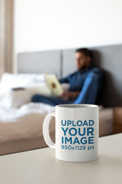 Coffee Mug Mockup with a Man Reading a Book in the Background 24024