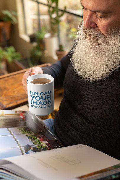 Mug Mockup of a Man Drinking Tea and Reading a Book 23977