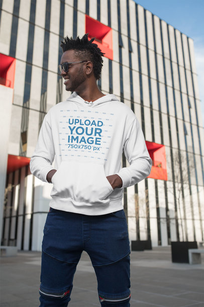Pullover Hoodie Mockup of a Man Standing in Front of a Building 24319