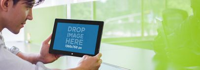 Tablet Mockup of a Young Man Using a Microsoft Surface a4776