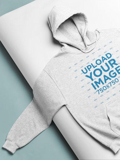 Mockup of a Pullover Hoodie Over a Backdrop Paper Roll 24363