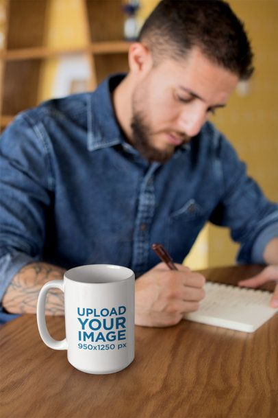 Mug Mockup of a Handsome Man Writing in His Journal 24023