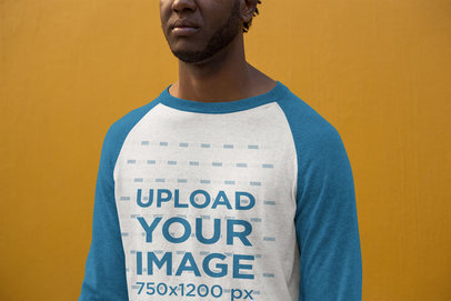 Long Sleeve Raglan Tee Mockup of a Man Standing Against a Solid Color Wall 24116