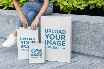Gift Bags Mockup Featuring a Woman on a Bench 24040