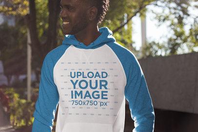 Mockup of a Smiling Man Wearing a Raglan Hoodie 24112