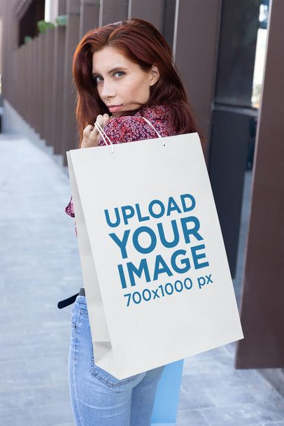 Gift Bag Mockup Featuring a Red-Haired Woman Walking Down the Street 24051