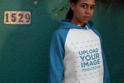 Mockup of a Serious Woman Wearing a Raglan Hoodie  24148
