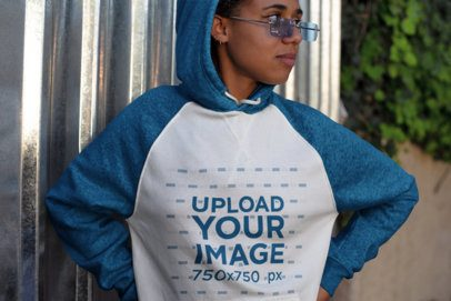Raglan Hoodie Mockup Featuring a Girl with Glasses Looking Away 24151