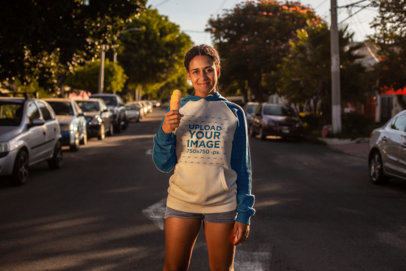 Raglan Hoodie Mockup of a Woman Eating an Ice Cream Cone at Sunset 24164