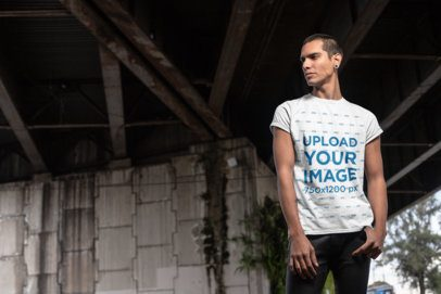 T-Shirt Mockup of a Man with an Attitude Standing Under a Bridge 24535