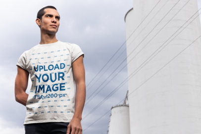 Mockup of a Man Wearing a Tee on a Cloudy Day 24521