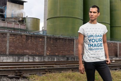 Mockup of a Man Wearing a T-Shirt in an Industrial Zone 24522