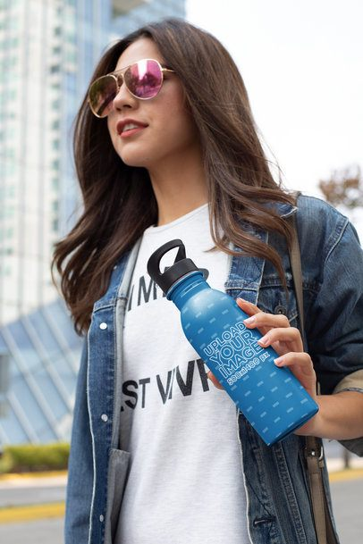 Mockup of a Fashionable Woman Holding an Aluminium Water Bottle 24417