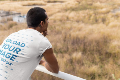Back View Mockup of a Man Wearing a T-Shirt Looking to the Horizon Outdoors 24529