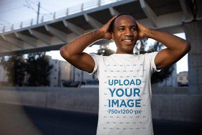 T-Shirt Mockup of a Smiling Man Having a Good day 24074