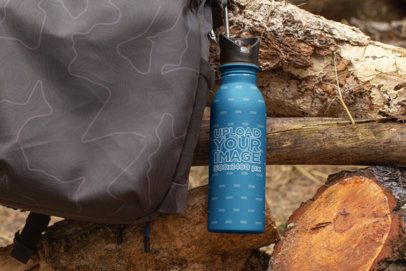 Mockup of an Aluminum Water Bottle Clipped onto a Backpack 24434