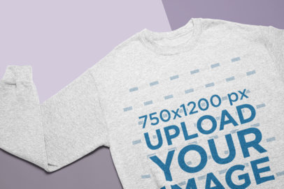 Mockup of a Heathered Sweatshirt Lying Over Pasteboards 24734