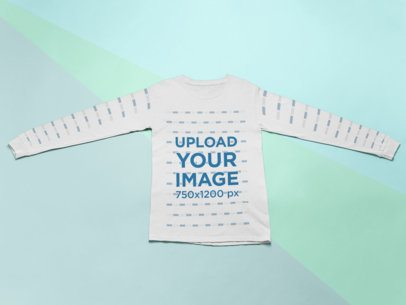 Flat Lay Mockup of a Long Sleeve Tee Lying over a Colorful Surface 24577