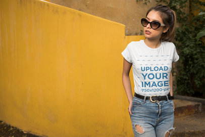 Mockup of a Woman Wearing a T-Shirt in Front of a Yellow Wall 24643