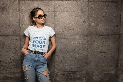 Mockup of a Cool Woman Wearing a Tee and Jeans Against a Stone Wall 24644