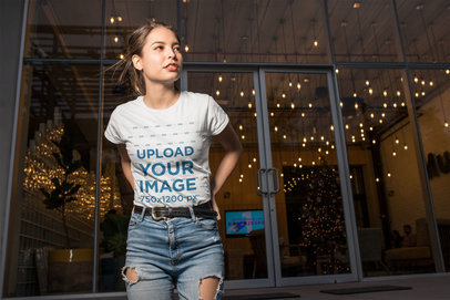 Tee Mockup of a Woman Looking Towards the Street at Night 24649