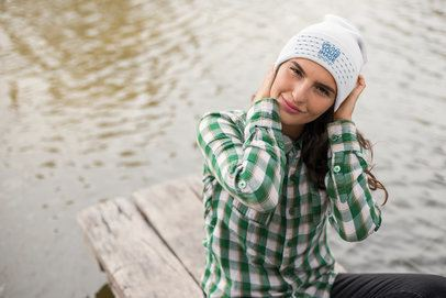 Mockup of a Woman Adjusting Her Beanie Sitting by a Lake  24628