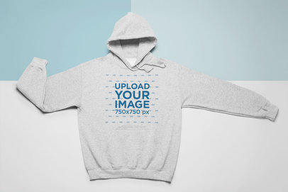 Hoodie Mockup in Flat Lay Position over a Custom Flat Background 24755