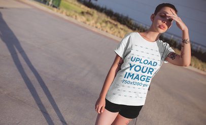T-Shirt Mockup of a Cool Woman Blocking Her Eyes from the Sun 20180