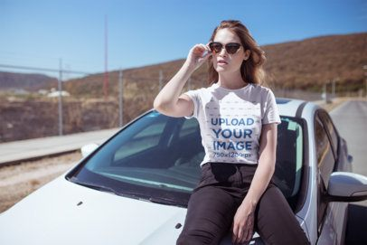 T-Shirt Mockup of a Cool and Trendy Woman Sitting on a Car 20065