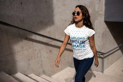Mockup of a Woman Walking Up Stone Steps Wearing a T-Shirt  24658