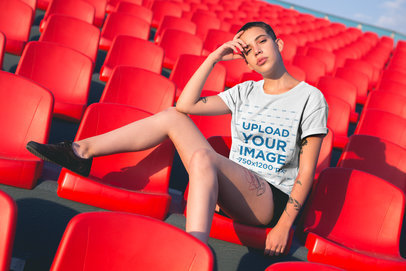 T-Shirt Mockup of an Edgy Woman Surrounded by Red Stadium Seats 20183