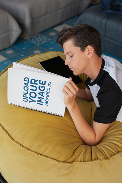 Notebook Mockup of a Boy Reading 24143