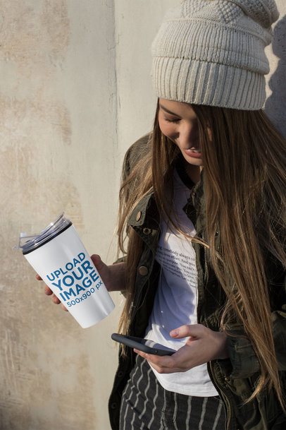 Travel Mug Mockup Featuring a Girl Looking at Her Phone 24337