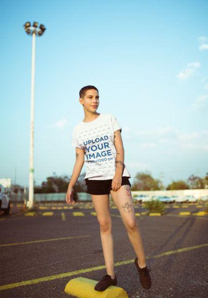 T-Shirt Mockup of a Smirking Woman Balancing on a Parking Stop 20188