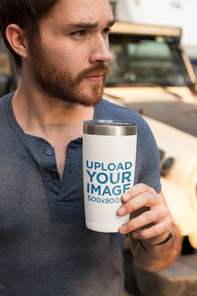 Mockup of a Serious and Handsome Man Holding a Travel Mug 24399