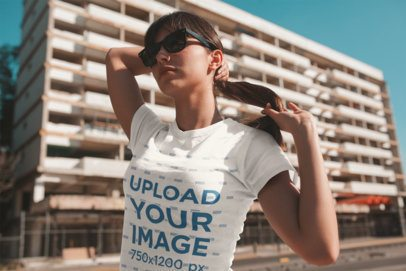 T-Shirt Mockup of a Girl with a Ponytail and Sunglasses on the Street 19612