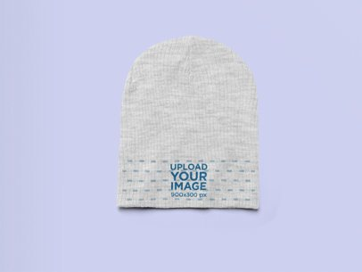 Flat Lay Heather Beanie Mockup Featuring a Solid Background 24565