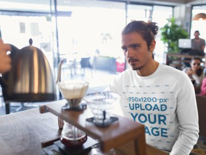 Crewneck Sweatshirt Mockup of a Man at a Cafe 18065